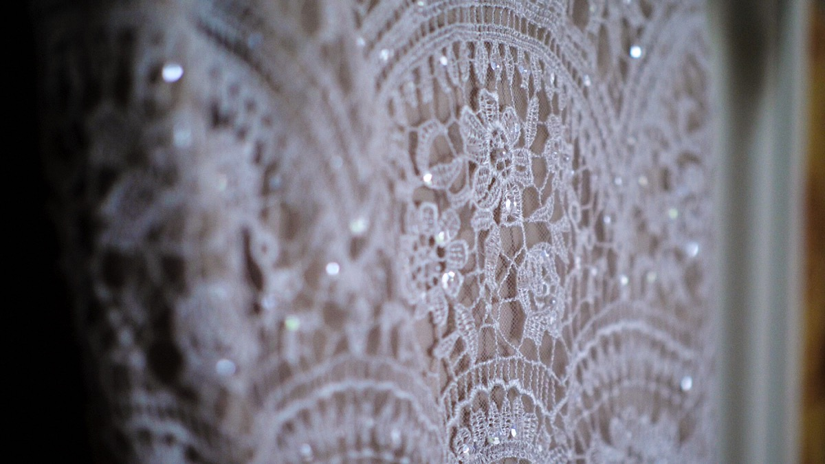 The morning of Phil and Emma's wedding day at the beautiful North West Wedding Venue, Knowsley Hall. Emma's wedding dress shows beautiful sequins and a floral design.