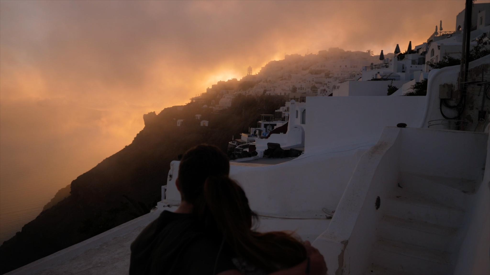 Gareth and Sara share a hug, whilst admiring a Santorini sunset.