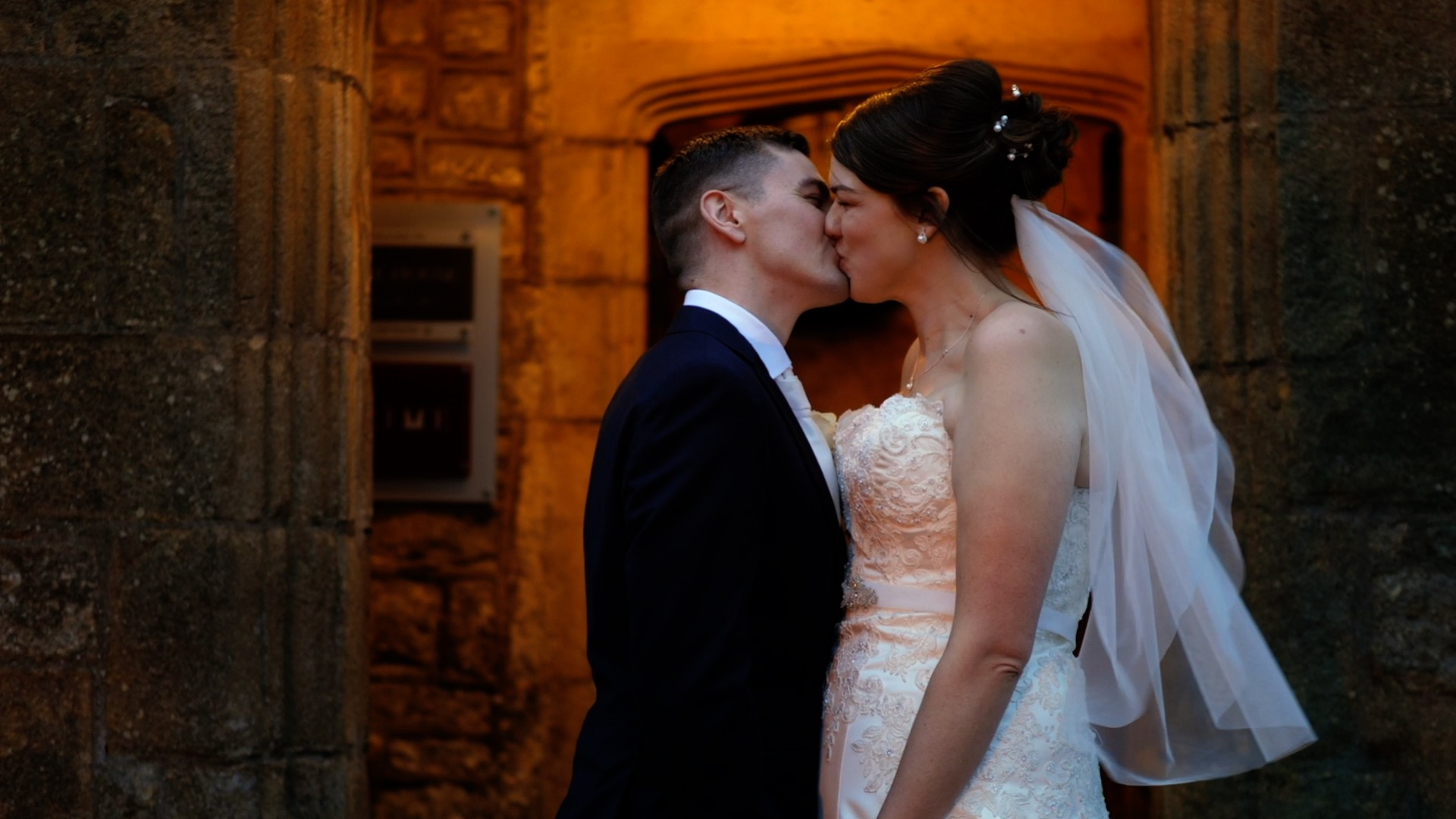 Fay and Mark share a kiss outside Stirk House Wedding Venue: a rare moment for them outside, as the day was filled with rain!