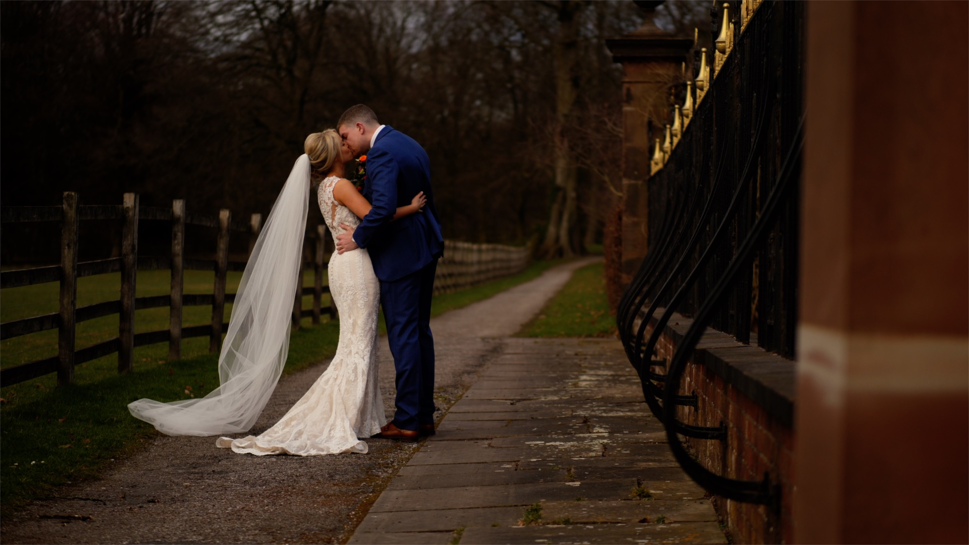 Jen and Dan, the bride and the groom, share a kiss after their wedding ceremony in the grounds of the stunning wedding venue, Knowsley Hall, Prescot, near Liverpool.