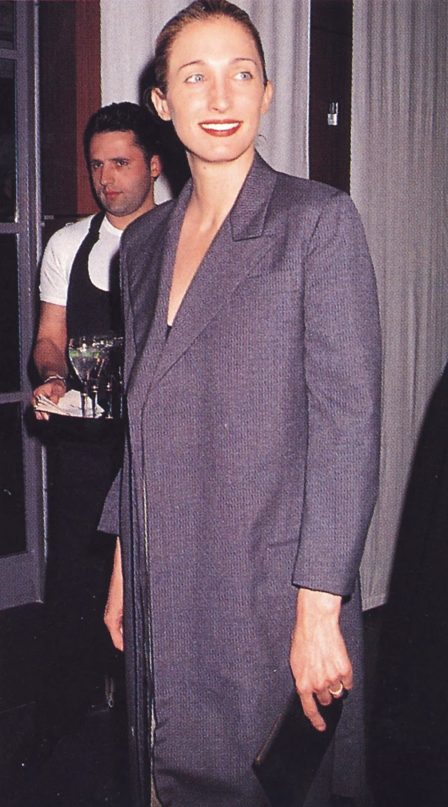 In a Spring 1999 Yohji Yamamoto pin stripe jacket and black slip dress at a Krizia exhibition