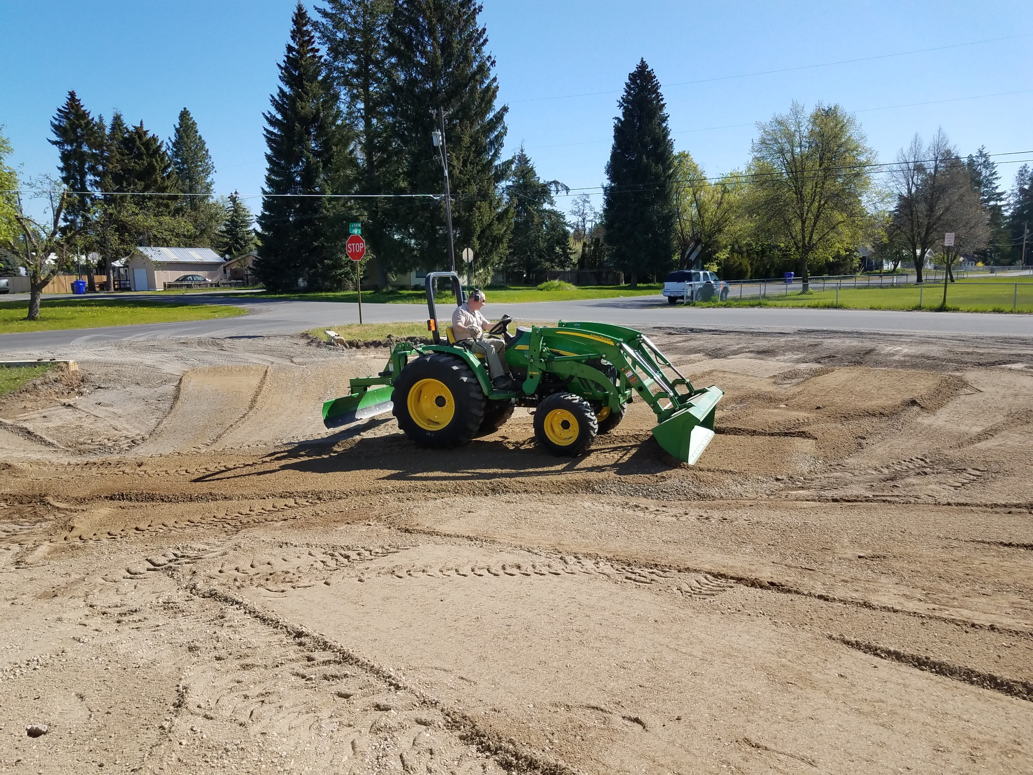 Jeff Hickethier donated his tractor and time to prep for paving by spreading the gravel to grade.