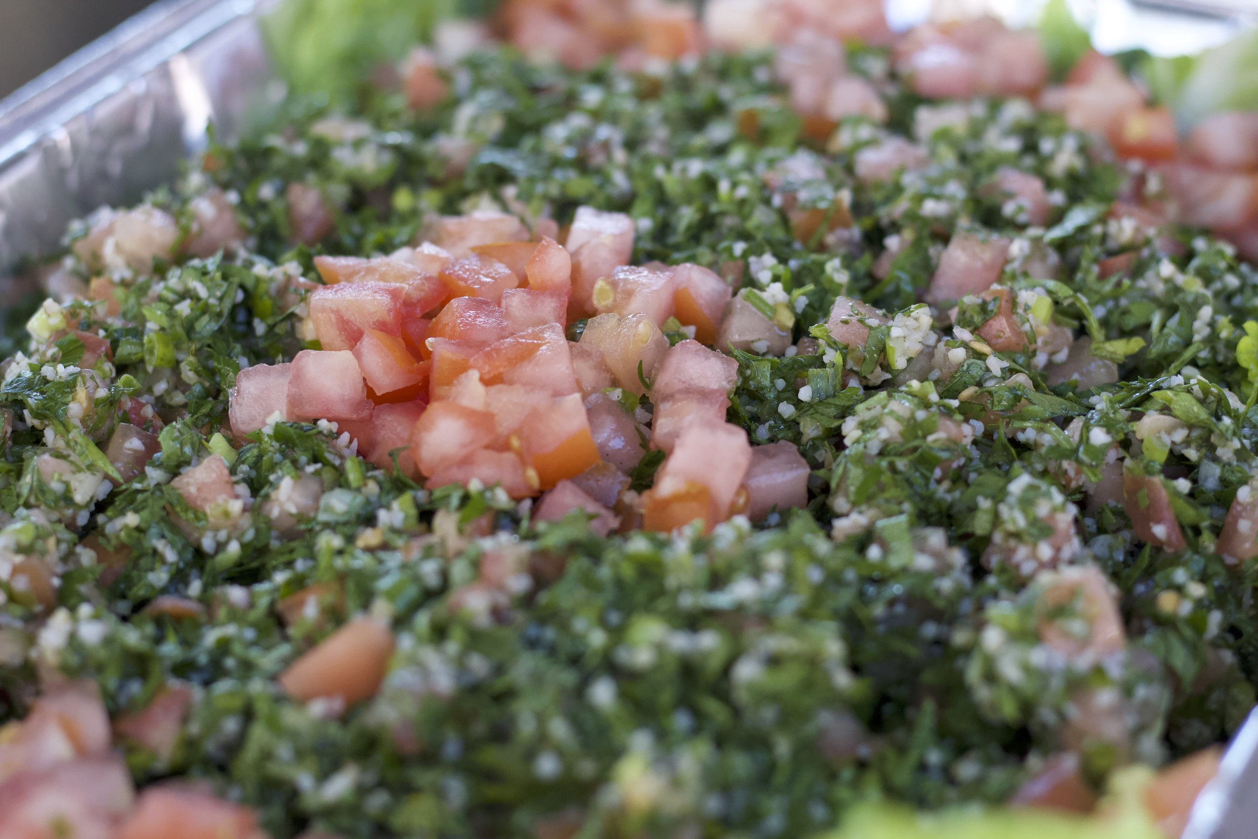Tabouleh VV - $7.00   Chopped parsley mixed with cracked wheat, onions, tomatoes, and scallions. Seasoned with olive oil, lemon juice, and mint.