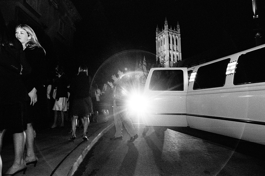 Students from the exclusive National Cathedral School arrive in a limousine to attend the school's Christmas party.  December 2004.  © Kike Arnal