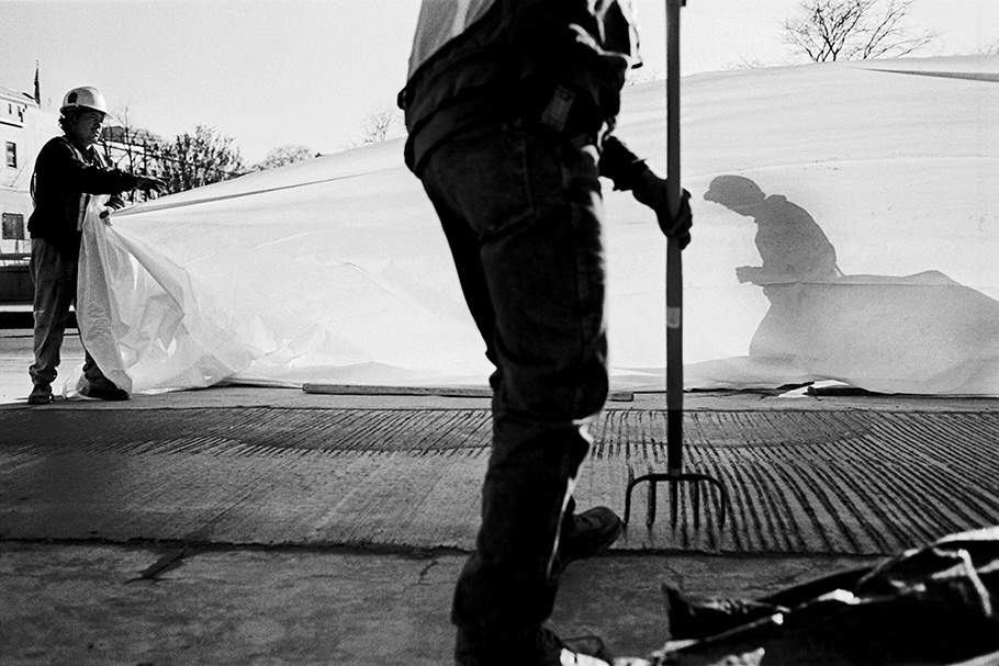 A construction crew works on a street close to the Capitol. Washington, D.C. is experiencing rapid gentrification.  October 2003.  © Kike Arnal