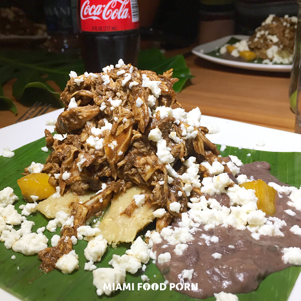 Pulled Chicken Mole, tamal in banana leaves, frijoles