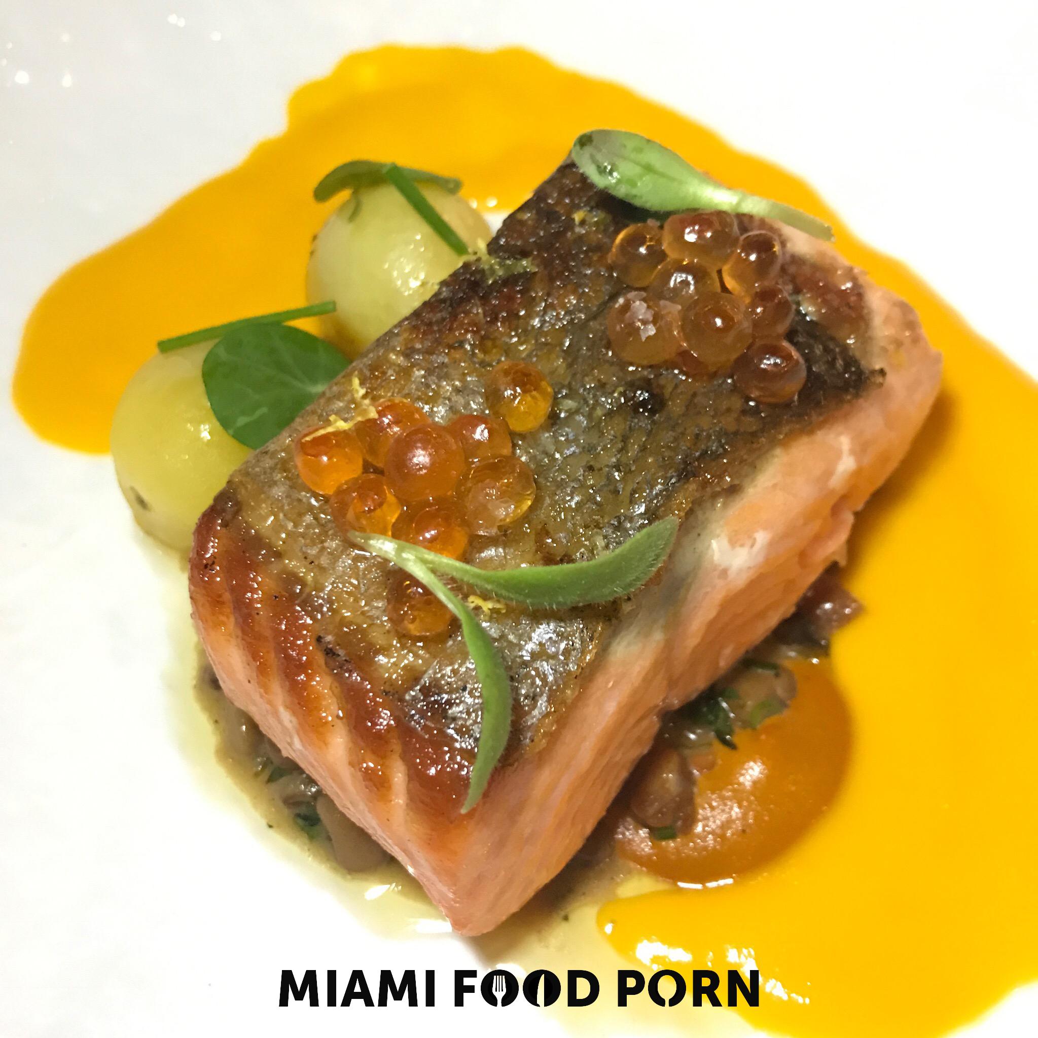 Wild Ora King Salmon with anson mills peas, caper sofrito, smokey pork and tomato-dill vinaigrette