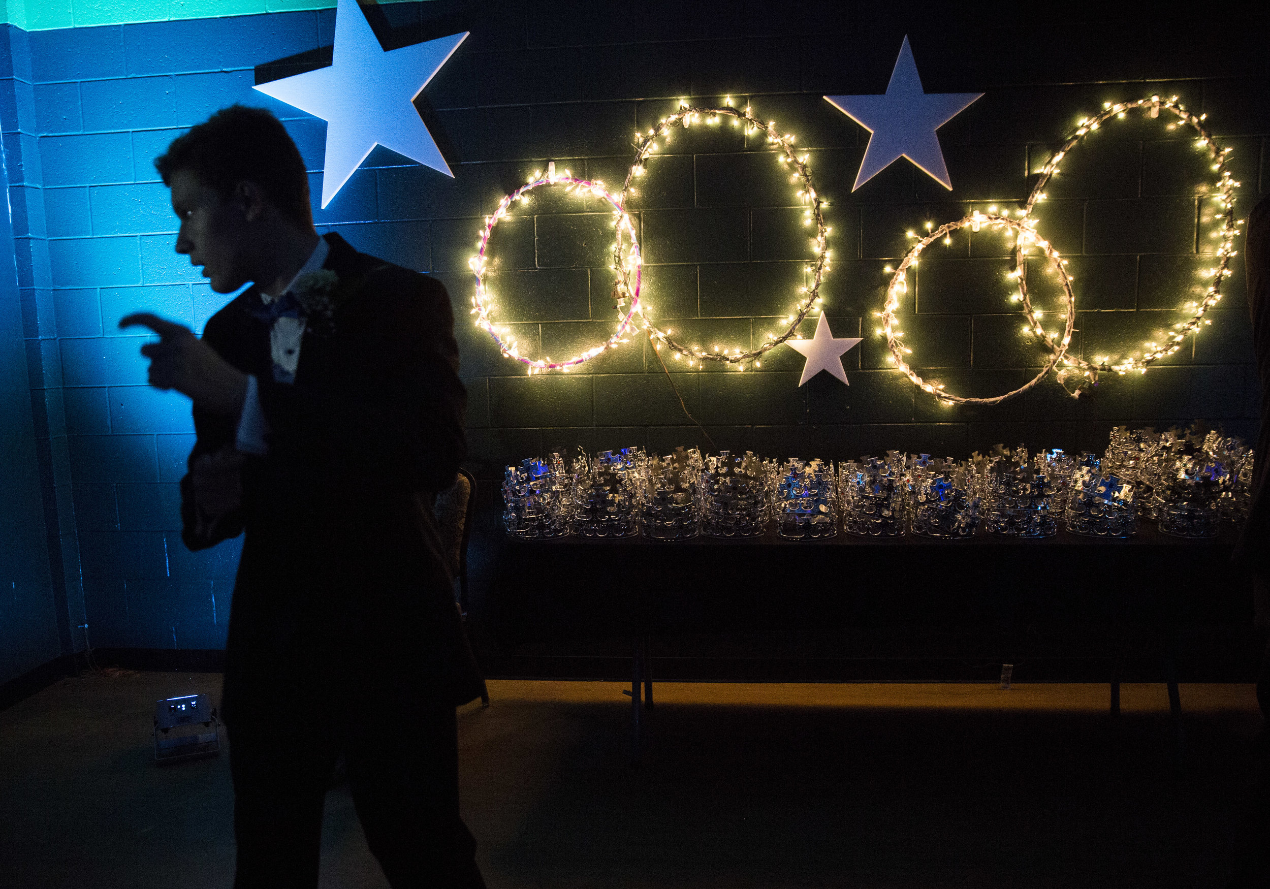 Travis Dixon dances in front of a table of crowns at the Night to Shine event in Naples, Fla. on Friday, Feb. 9, 2018. Night to Shine is a worldwide event put together by the Tim Tebow Foundation to give those with special needs a total prom night experience.