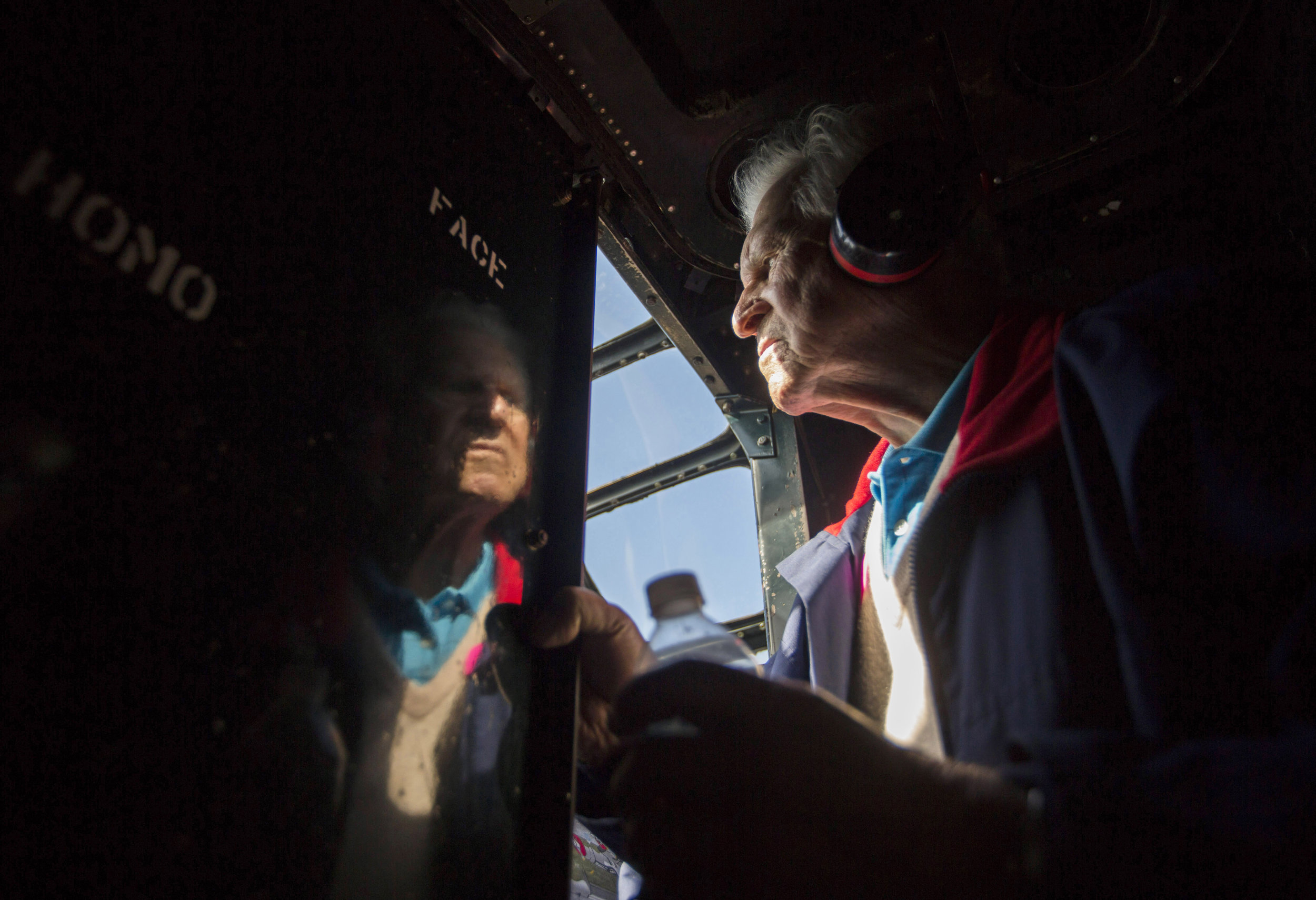 Ernie Kunz, 92, looks into the cockpit of a Consolidated B-24 Liberator during a flight from Vero Beach Fla. to the Naples Municipal Airport on Thursday, Feb. 1, 2017. The flight was made possible by the Collings Foundation to give veterans an opportunity to experience flight in the restored aircraft.