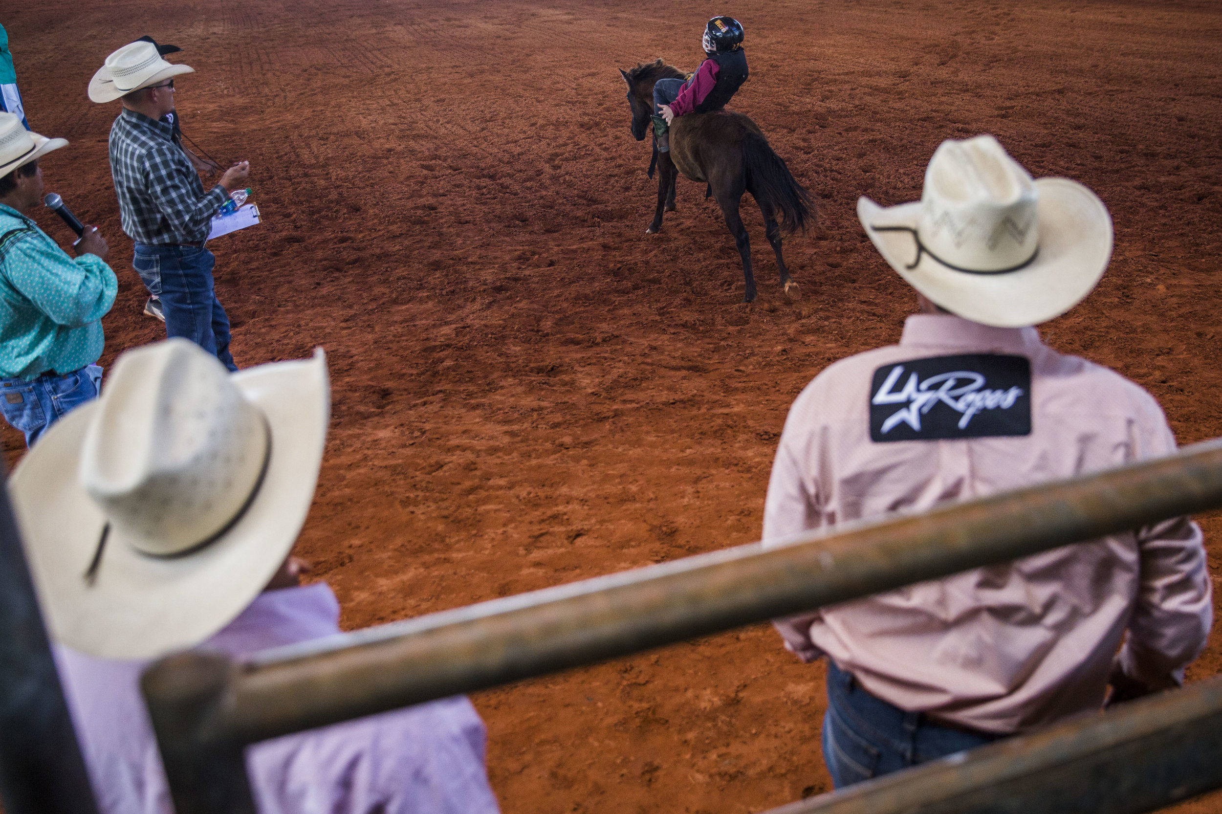 Rodeo judges and participants watch the youth pony riding during the Junior Cypress Memorial Rodeo at the Junior Cypress Rodeo Arena in Clewiston, Fla. on Saturday, March 17, 2018.