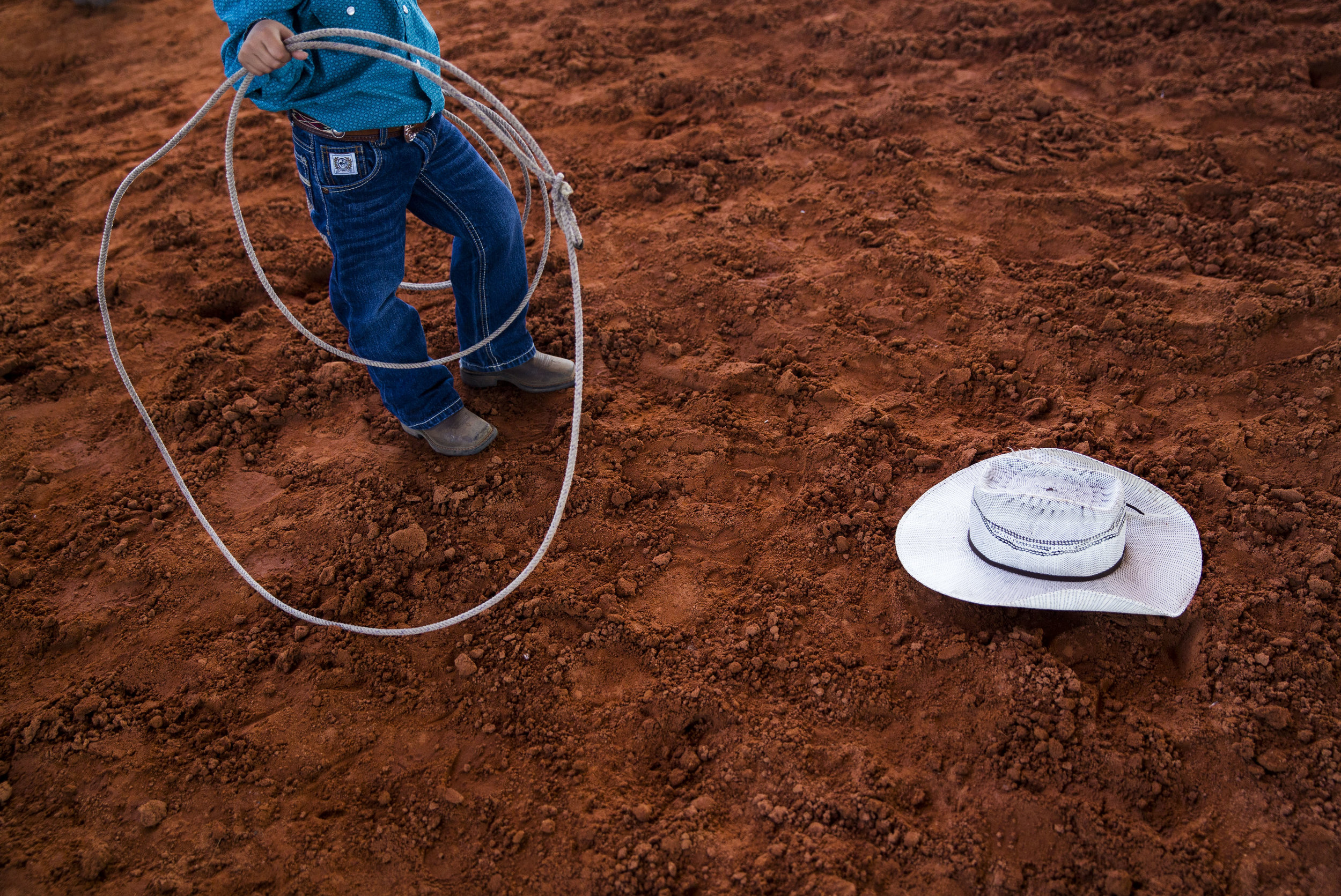 A kid roping participant lines up to practice his roping for the youth events during Junior Cypress Memorial Rodeo at the Junior Cypress Rodeo Arena in Clewiston, Fla. on Saturday, March 17, 2018.