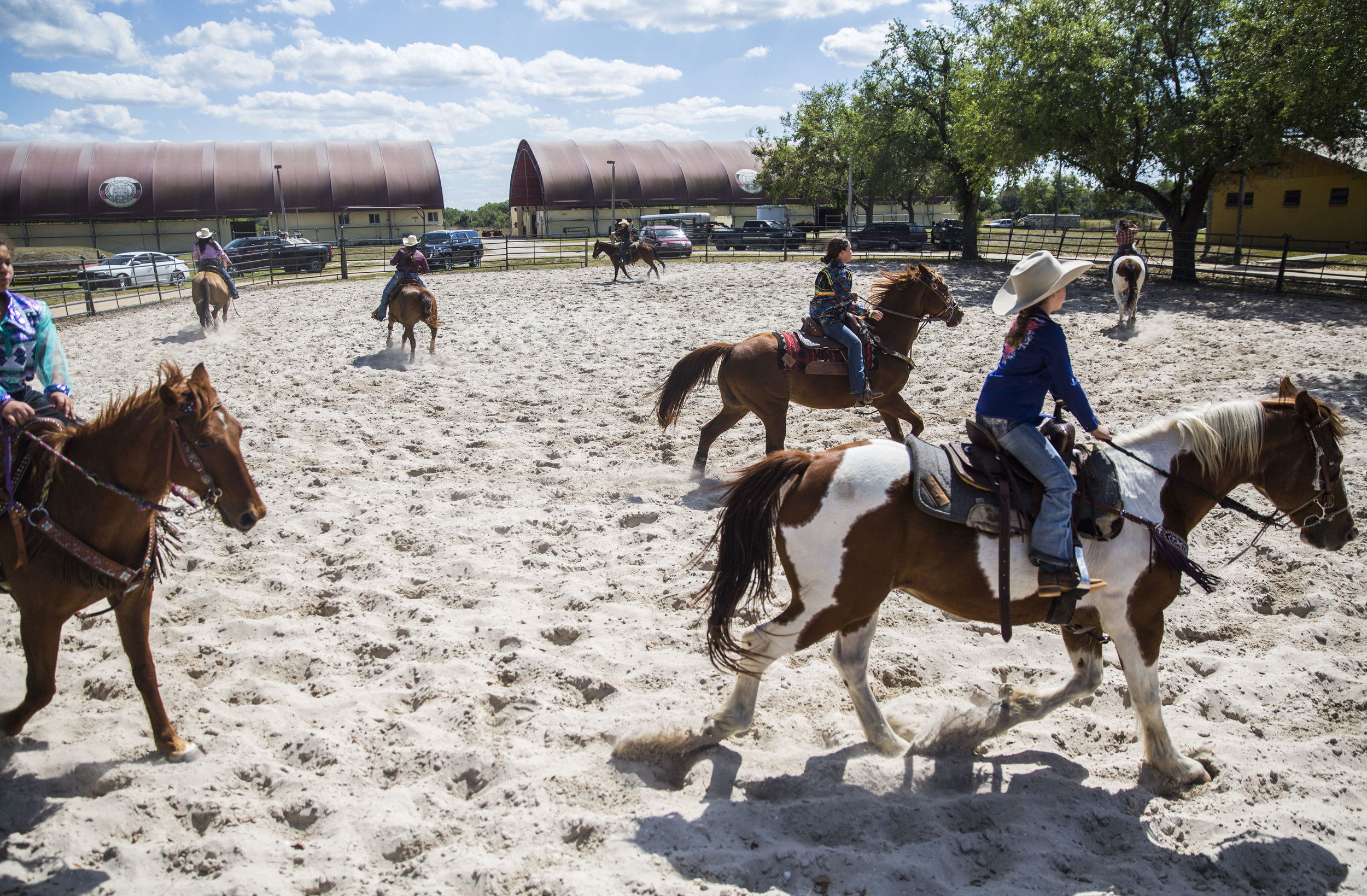 Rodeo participants warm up in the outdoor arena during the Junior Cypress Memorial Rodeo at the Junior Cypress Rodeo Arena in Clewiston, Fla. on Saturday, March 17, 2018.