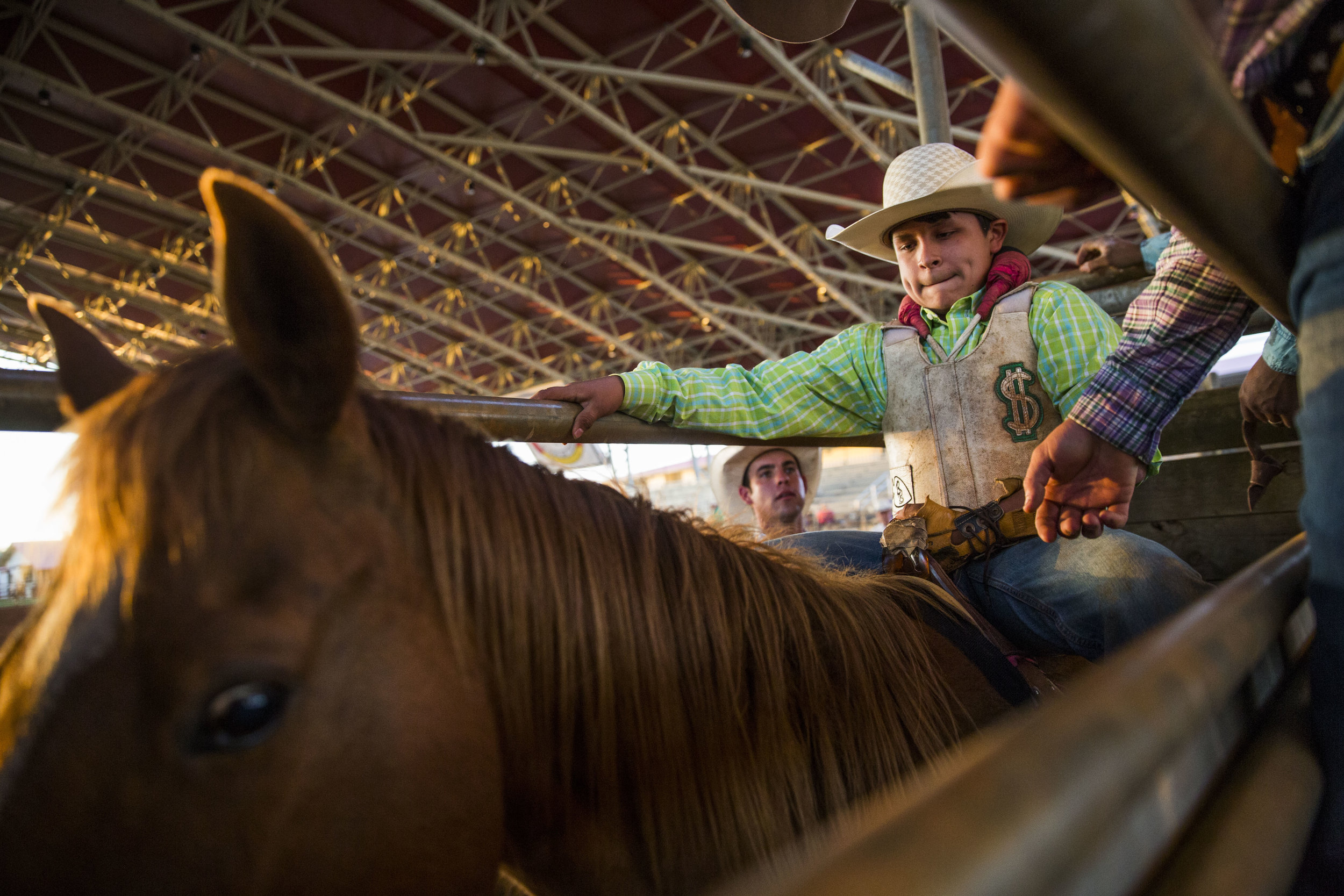 Chunky Osceola waits for the pen gate to open during the Junior Cypress Memorial Rodeo at the Junior Cypress Rodeo Arena in Clewiston, Fla. on Saturday, March 17, 2018.