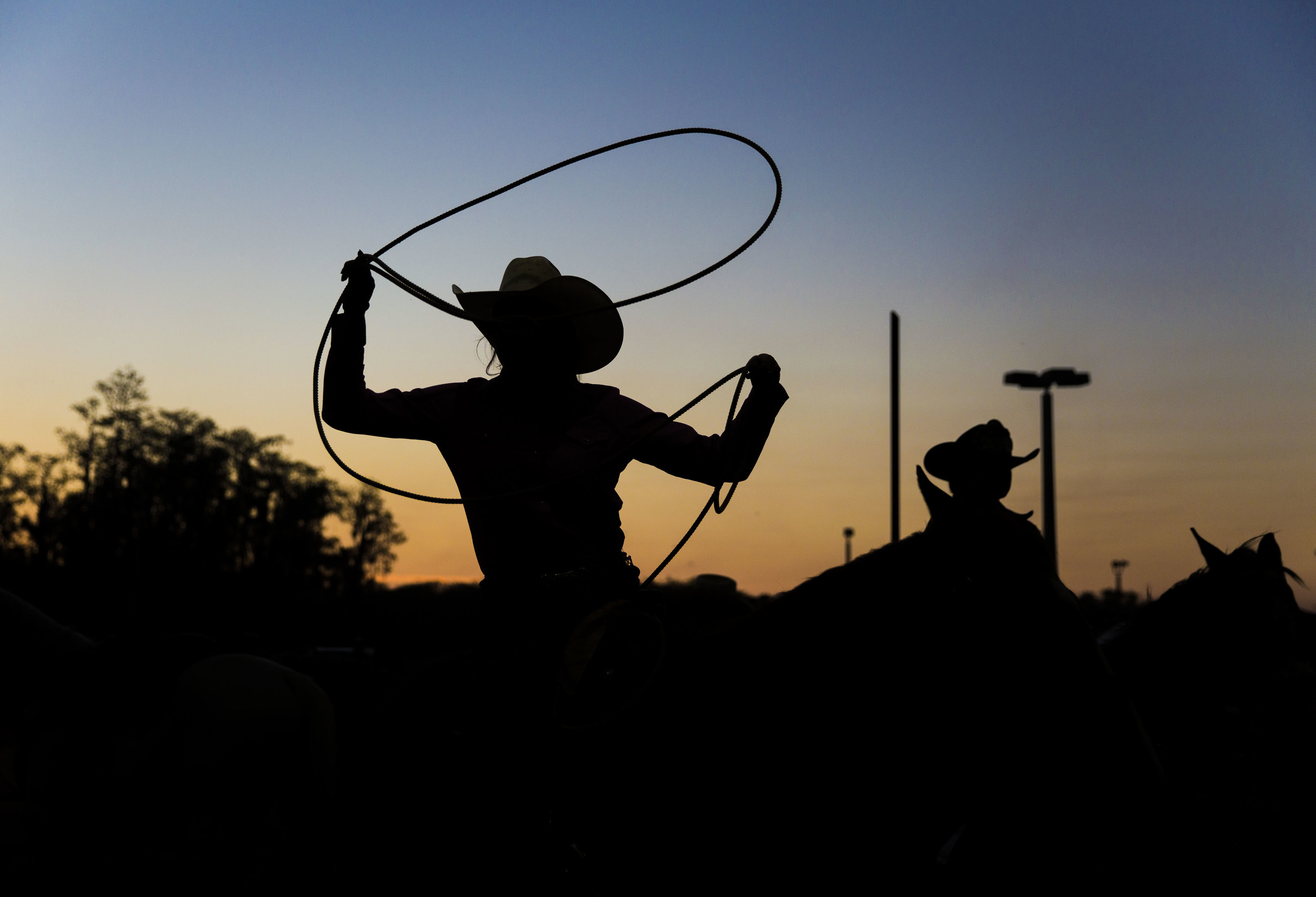 Riders warm up outside of the arena before the start of team roping during the Junior Cypress Memorial Rodeo at the Junior Cypress Rodeo Arena in Clewiston, Fla. on Saturday, March 17, 2018.