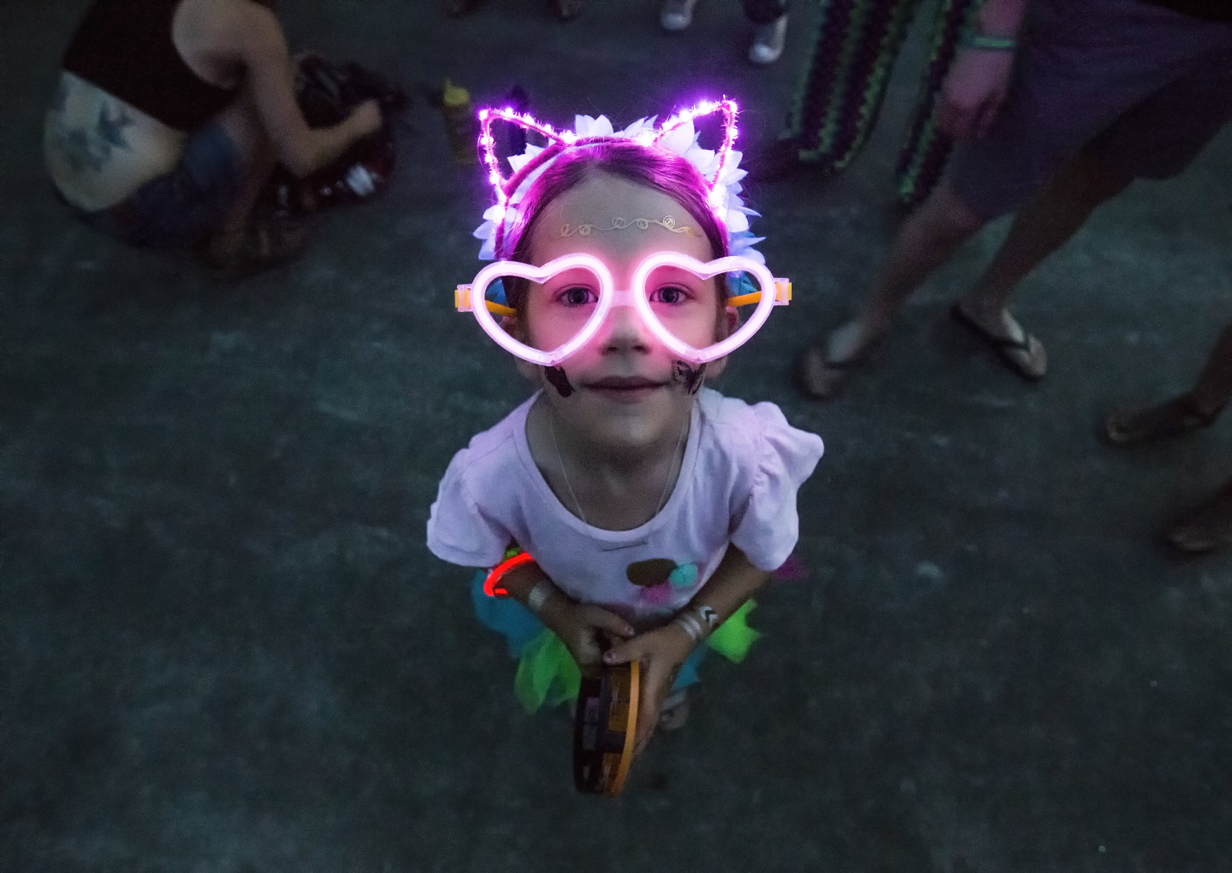 Audrey Parrish, 6, stops dancing to pose for a portrait in her cat costume during the Summer Meltdown festival in Darrington, Wash. on Aug. 8, 2018.
