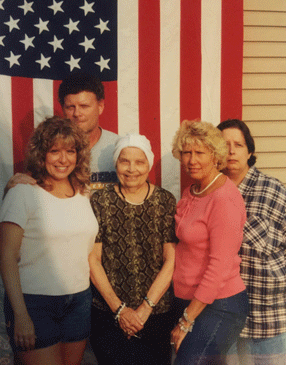 Patty's family in front of her father's flag.