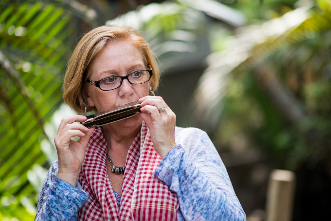Susan playing her dad's harmonica.