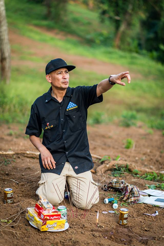 Ron Reyes points to the area where his father was killed on a hill overlooking Khe Sanh. Every trip participant from the U.S. was able to visit the site where his or her father died, and to hold a service.