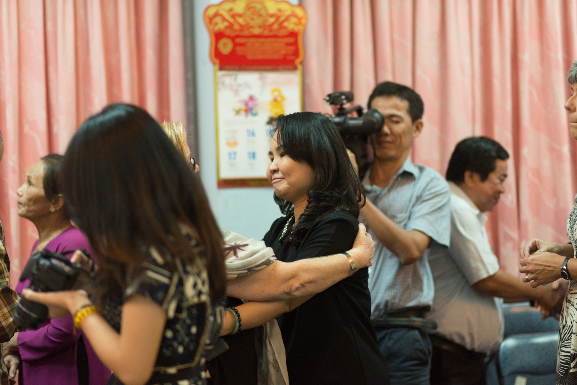 Ms. Diem gets a hug after the meeting. Photo courtesy Anthony Istrico.