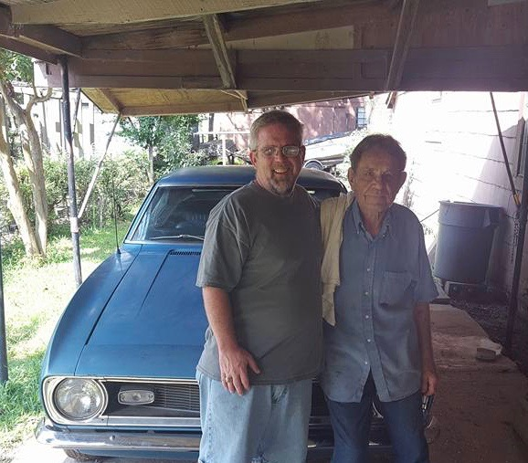 Mike with Grandpa Burkett and the Camaro.
