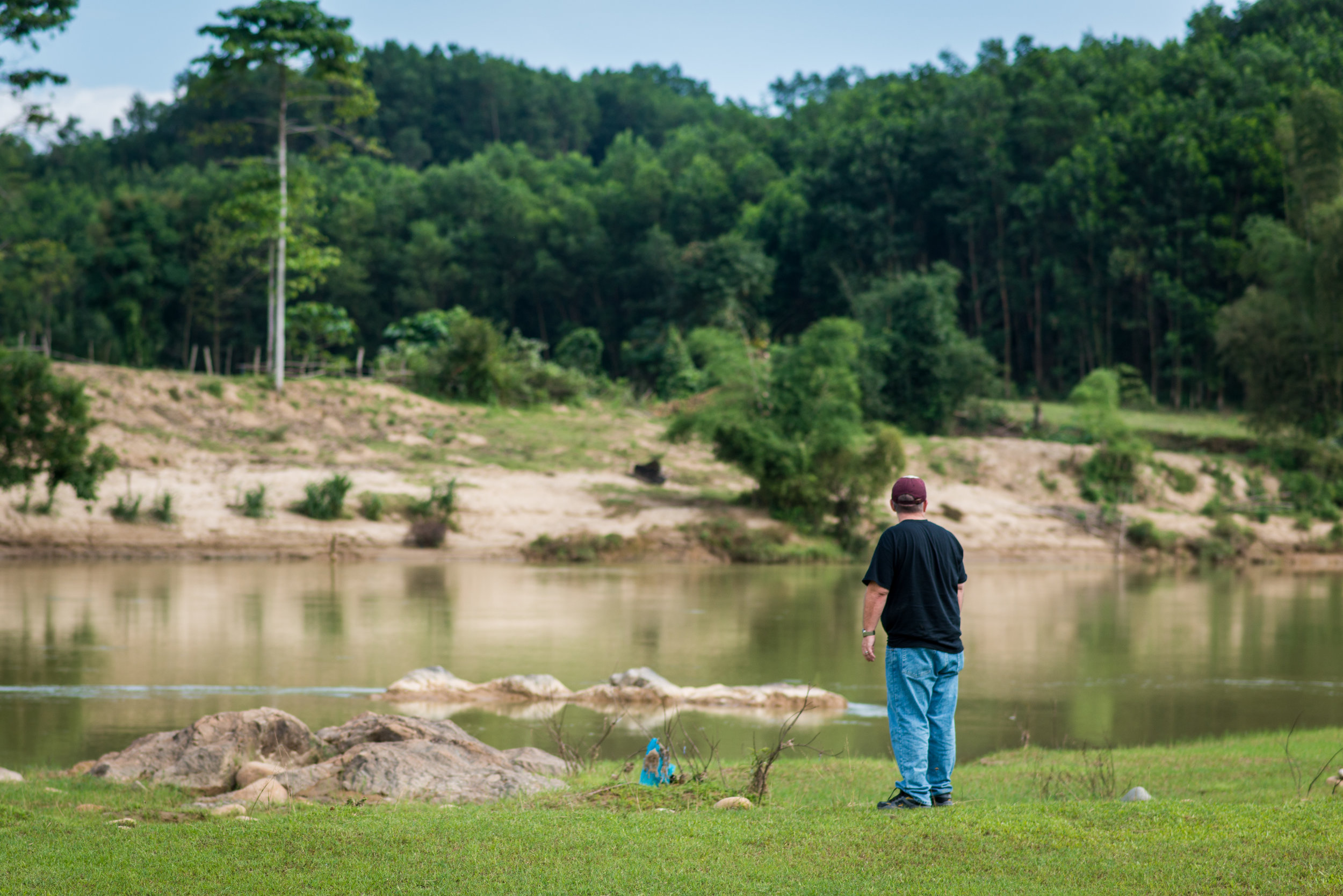 Mike Burkett looks upstream toward the area where his father drowned. Quang Ngai Province.