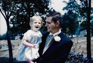 Kim and her father at a family wedding in 1964