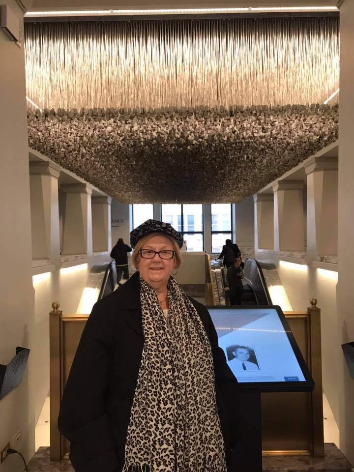 Susan in front of the dog tags exhibit, Chicago, 2018