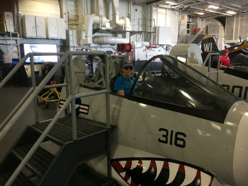 Trying out the fighter jets on the USS Midway aircraft carrier in San Diego.
