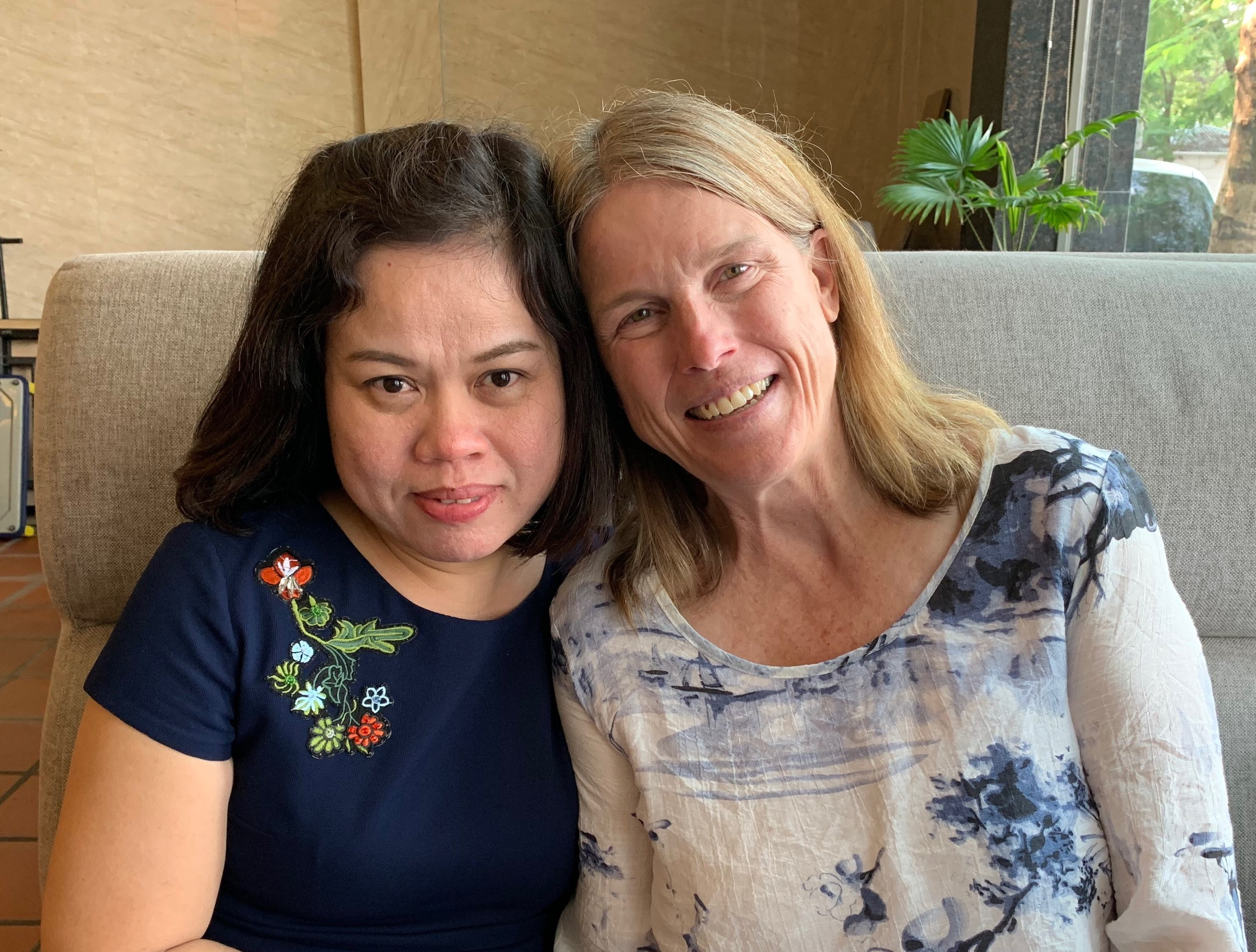"""Dung Vu and Barbara Brumet, whose fathers died fighting on opposite sides of the Vietnam/American War. Dung Vu's father died on April 8, 1972, before she was born. Barbara's father died on April 9, 1964, when Barbara was six years old. Barbara was the first to sign up for the 2018 trip. Dung Vu wasn't sure she wanted to come to the 2 Sides Project meeting, but in the end she was happy she did. """"We are all proud of our fathers, but we are not proud of war. I would do anything to prevent war."""""""