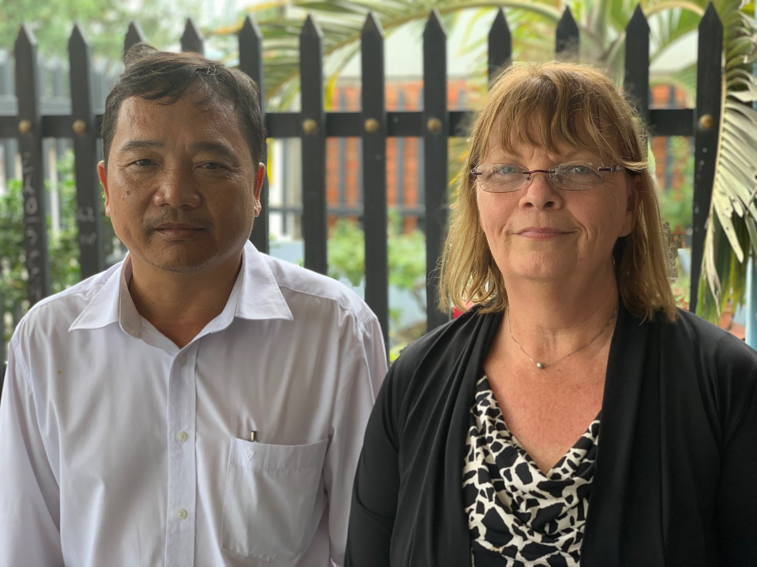 """Nguyen Hoang Giang and Jill Hubbs, whose  fathers died fighting on opposite sides of the Vietnam/American War. Giang's father, an educator, was killed in 1967 when Giang was two years old. Giang's uncle and grandfather also died during the war. Today Giang is an educator who believes """"we should do all in our ability to maintain peace for both sides."""" Jill is an educator too. Her father's plane crashed into the Gulf of Tonkin in March 1968. To this day he remains missing in action. """"In Vietnam I have met people who fought and who lost on the opposite side of the war, and they are all gracious and friendly toward me. It's been an amazing experience to connect with them."""""""