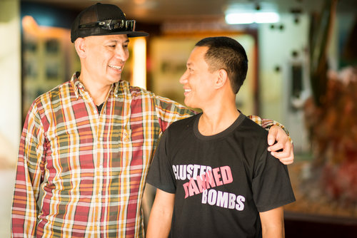 Ron Reyes and Phu Nguyen, who works at Project RENEW in the Quang Tri province. During a presentation about Project RENEW to the 2 Sides Project, Mr. Nguyen told Ron that his father was a guerrilla fighter and fought in Cam Lo, in the same place where Ron's father fought for the other side.