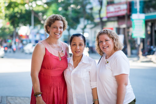 Margot Carlson Delogne, left, and Patty Young Loew, right, with Thi Le Phi. All three daughters said their mothers never remarried because they had found their one love in their fathers. They met in Da Nang, near the site where Patty's father was killed on March 11, 1969.