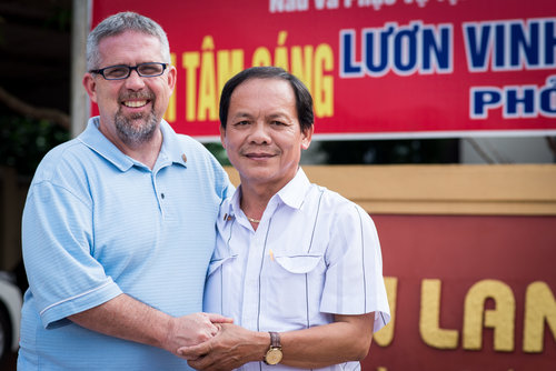 Mike Burkett with Ho Tuan Nghia after the 2 Sides Project meeting in Quang Tri. Both men share the experience of losing their father in war. They also share a love of photography.