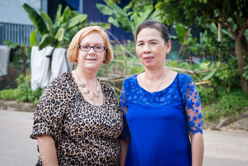 """Susan Mitchell-Mattera and Duong Thi Loan. Susan's father was killed near Cao Lanh City in 1970. Ms. Loan's father was killed in Quang Tri in 1968. Ms. Loan knew only the sound of her father's voice because he fought far from home. """"Once, he got a secret mission close to home and came to visit us. We met at night because we were scared. He hugged me, but in the dark I couldn't see his face."""""""