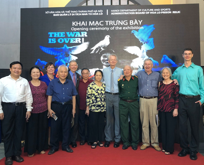 At the opening: Bui Van Nghi, (far left) former prisoner Robert Chenoweth (third from right), Robert's son Sean (far right), Chuck Searcy (center) and 5th from left Tim Wilbur, son of POW Colonel Robert Wilbur. Hanoi, 2019