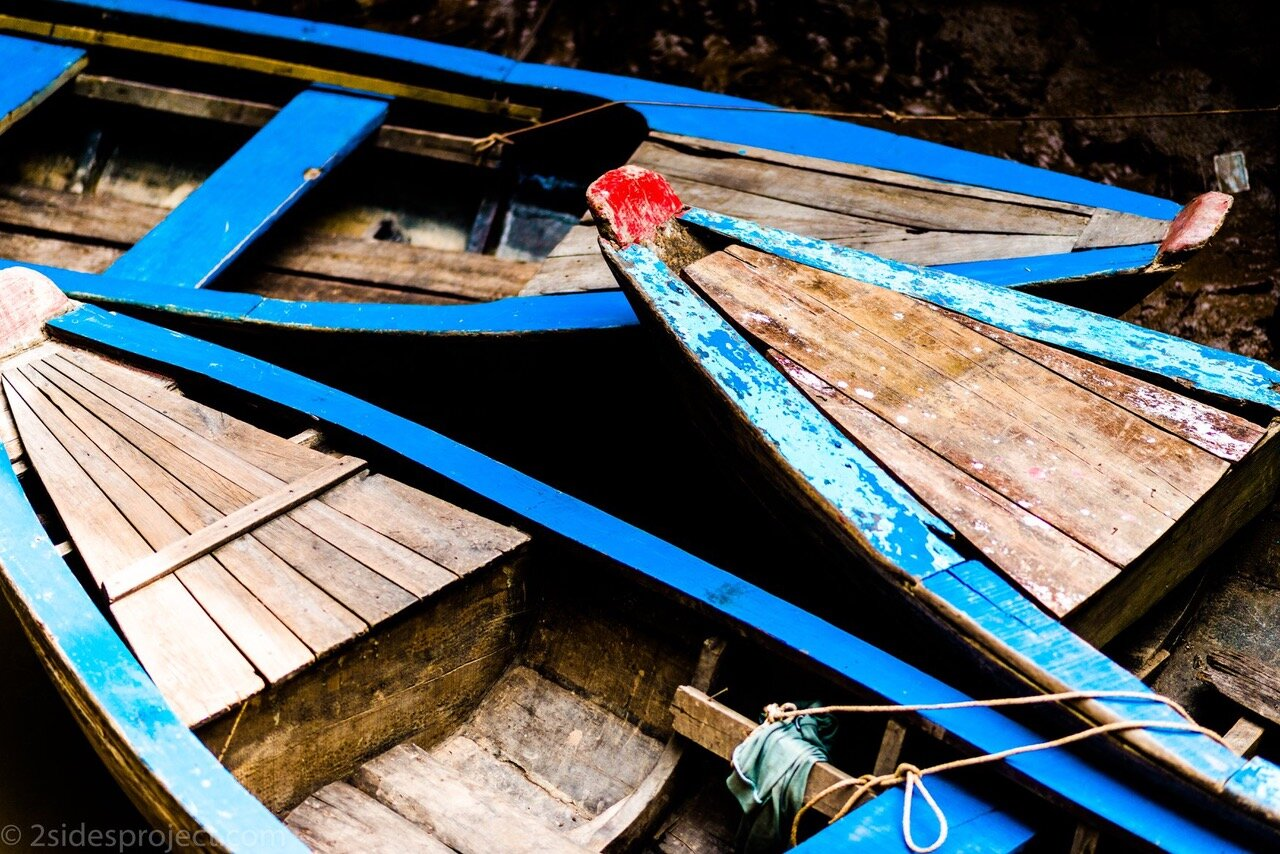 "Photographs from the 2 Sides Project trips to Vietnam: Blue Lines, by Anthony Istrico  ""We had traveled in these little rowboats down a very narrow stream of the Mekong River. I looked down from the docks and saw the most beautiful shades of blue. The colors just jumped out at me. This ended up being one of my absolute favorite shots from a composition perspective. The lines just seem to cut across the frame."" Blue Lines and more stunning photographs from Vietnam are available in any size (and purchases benefit the 2 Sides Project!) at  https://bit.ly/2SwXK4n ."