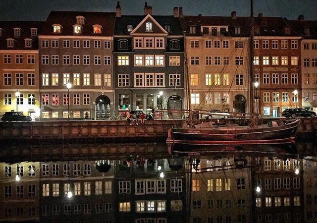 A beautiful night in Copenhagen; the water so still... An irresistible photo to take. - @laurabendavd