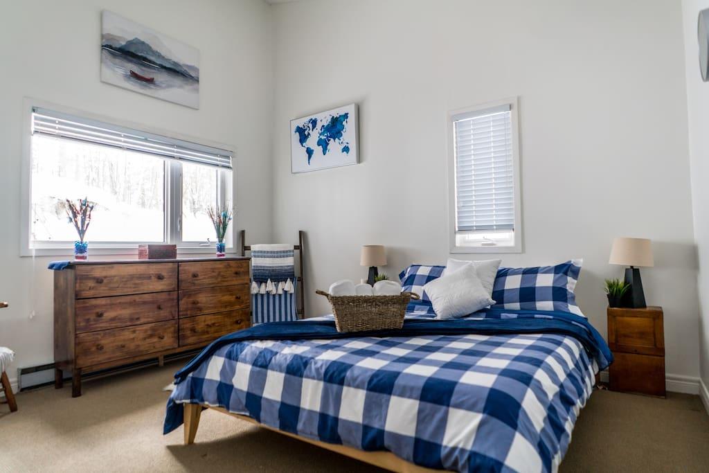 bedroom 2 with queen bed and elegant ensuite.jpg