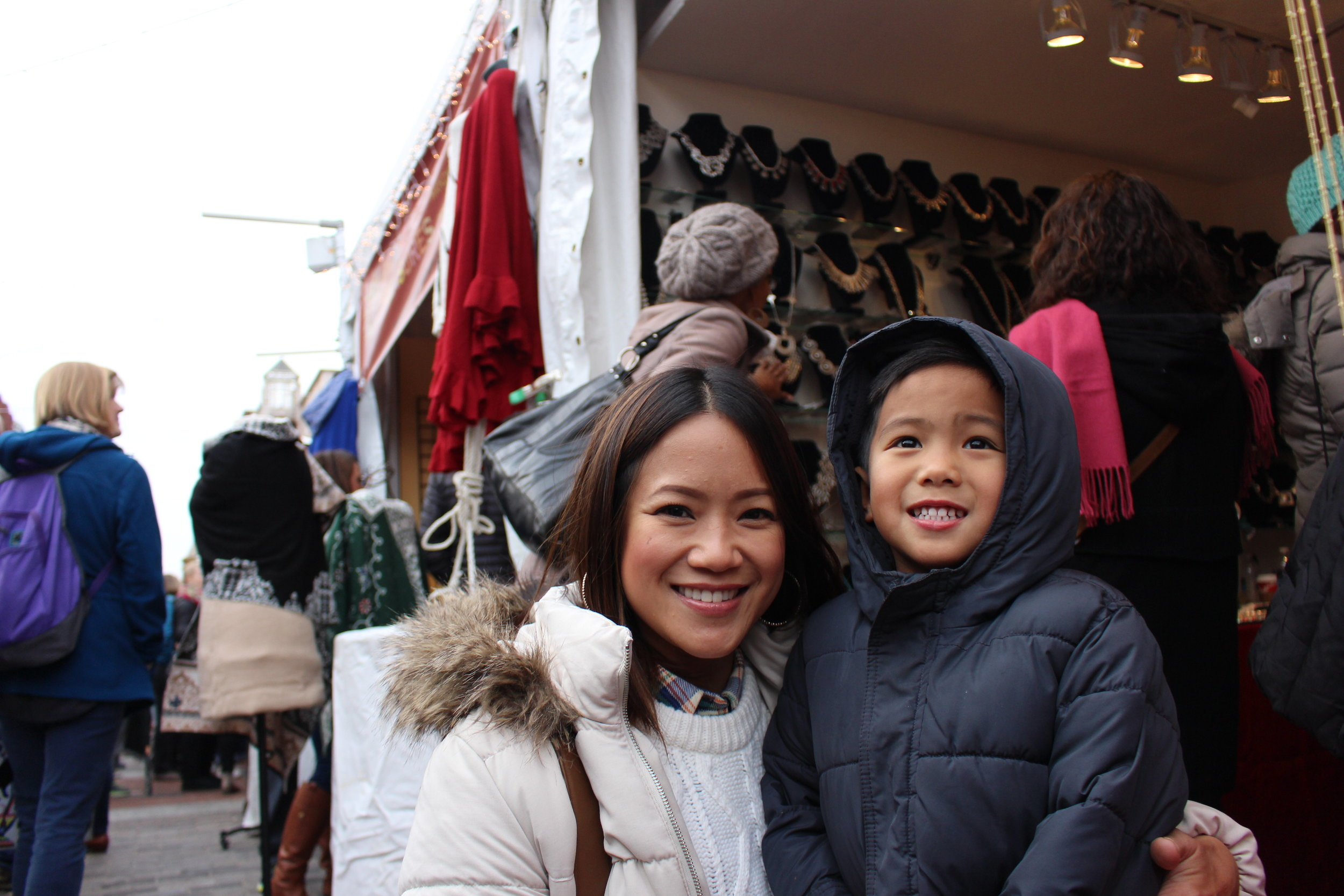 Denise Parco and her son Daniel pause for photo after wrapping it up at a jewelry booth. Photo by Natalie Hutchison.
