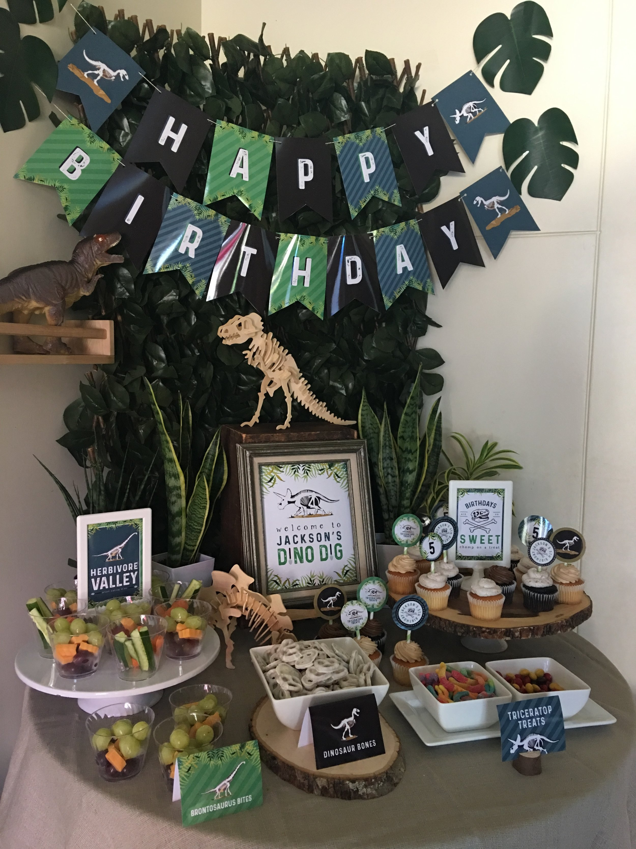 Dino Dig Party set up from MKKM Designs. Click to get some free printables and party ideas!
