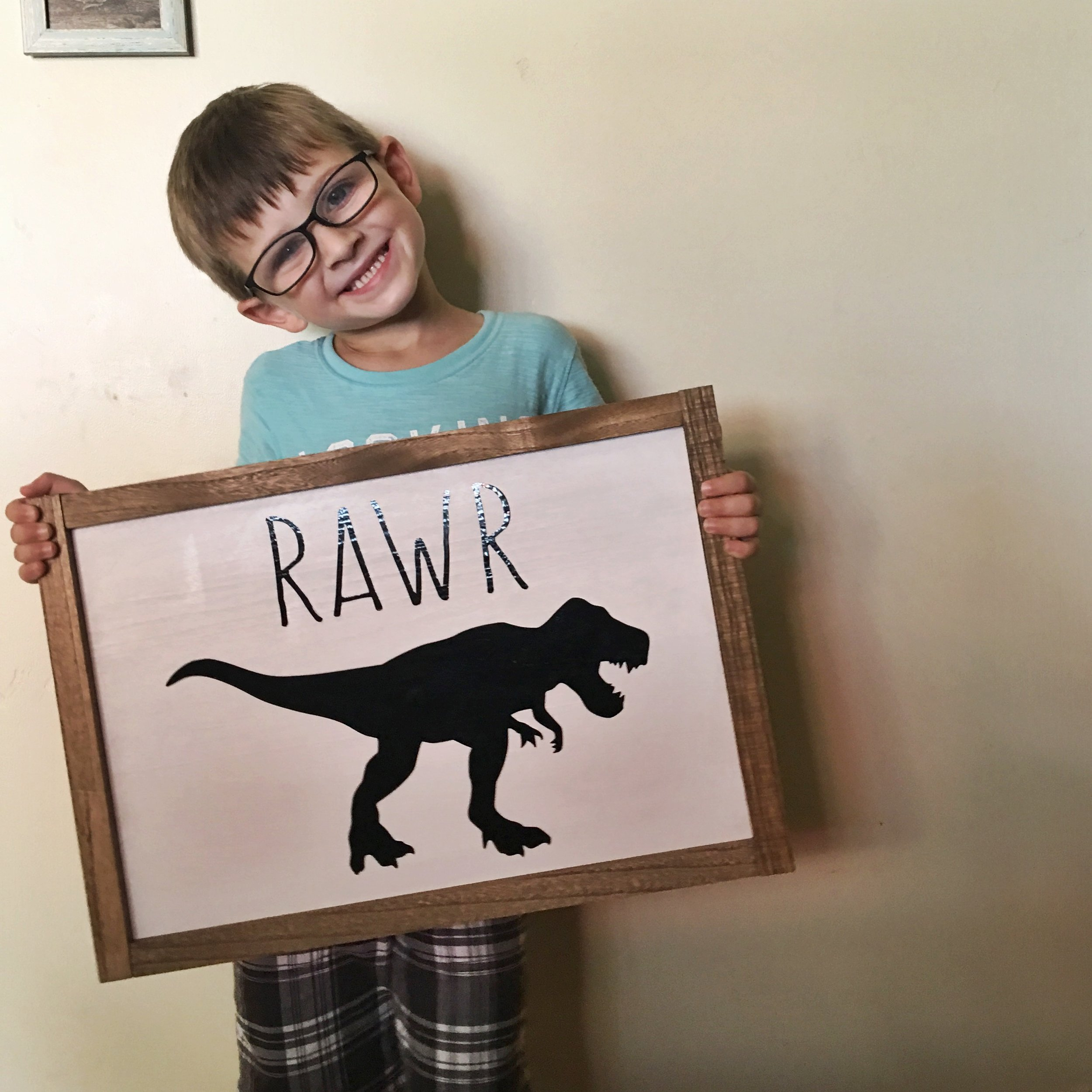 The cutest dinosaur sign with the cutest birthday boy. Sign from Stuck On You Oki.