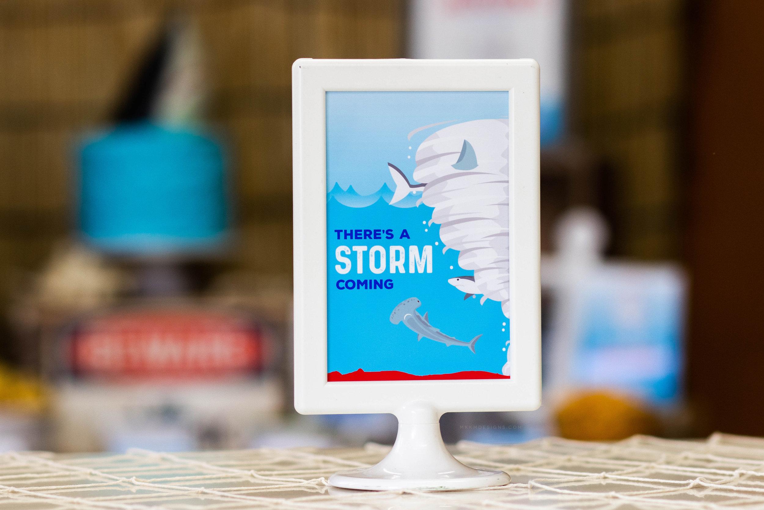 There's A Storm Coming Sharknado table sign // Shark Party Decor - Sharknado Birthday Party Ideas // mkkmdesigns