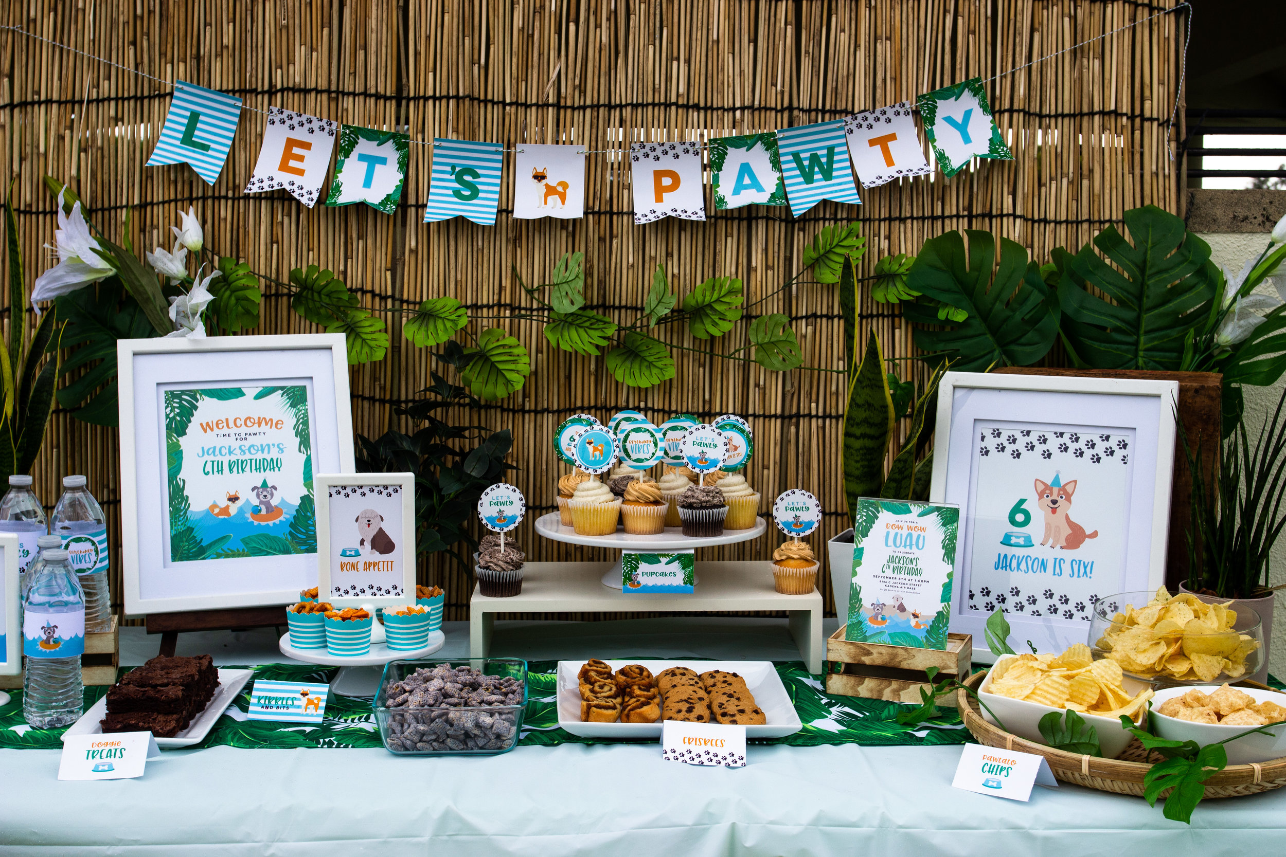 Puppy party decor. This Bow Wow Luau party is perfect for summer! Designed by MKKM Designs