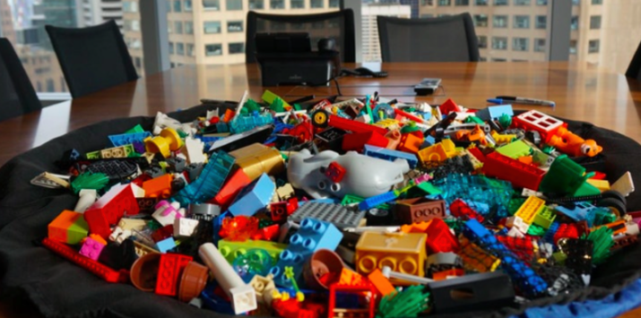 """Are you looking for ways to encourage teamwork at your company? Feeling like your business meetings lack energy and direction? Do you just love playing with blocks?  Join LEGO® Serious Play® master Michael Fearne as he demonstrates how PLAY can jumpstart your team. LEGO® Serious Play®, a methodology to bridge and harvest an organisation's collective intelligence to solve problems and improve decision-making, actively engages every participant and embraces a """"leaning forward"""" approach where everybody contributes. The bricks are used as a medium to build and to express complex ideas through storytelling and metaphors.  It unleashes creative energies, modes of thought and ways of seeing that most adults have forgotten they even possessed. Dare to play!"""