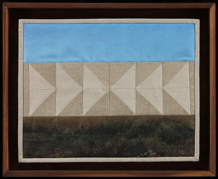"""Geese Collide Overhead,  2014  16"""" x 20.5"""" framed  Quilt: linen canvas, batting, thread, muslin"""