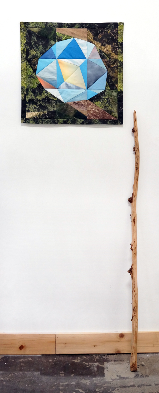 "Sky Orb and Stick , 2015  19.75""x20"" textile and redwood stick.  linen canvas, thread, wood, magnets"