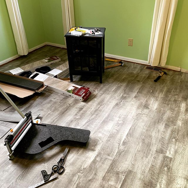 A couple rows left, but not bad for an afternoon. Hoping to get the floor finished and the walls painted tomorrow night. The flooring is Stony Oak Gray luxury vinyl plank from @homedepot . [image of vinyl flooring with tools and loose planks strewn about. It's a nice roughsawn gray flooring, and the walls are currently green, but not for long.]