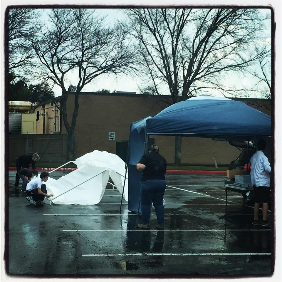 setting up in the rain.jpg