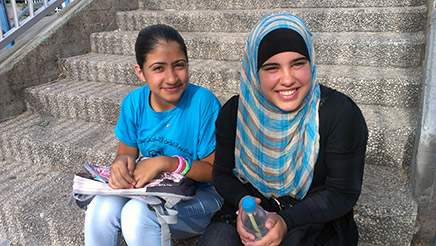 Layla and Hidaya are both in the Grade 8 class and aged 13. They both like Arabic and English at school and their favorite band is One Direction. Layla's favorite class at camp has been Math and she says she is so excited for the next year! They have dreams to be a doctor/singer and a public speaker.