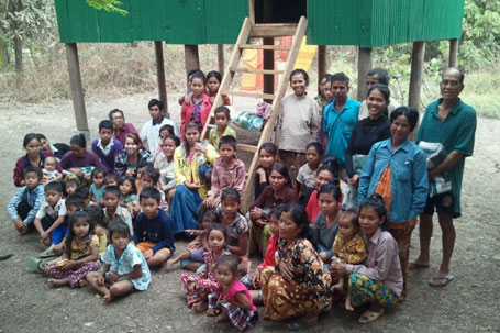 Villagers ready to move in to their new homes.